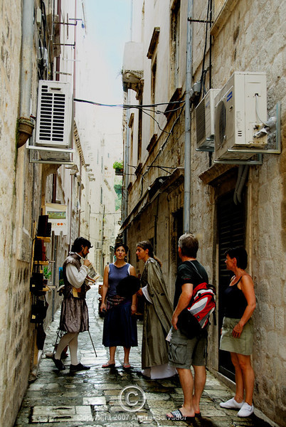 Costumed players discussing their play at the side street.