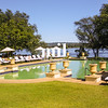 Green Swimming Pool at the hotel in Zambia with Zambezi flowing behind