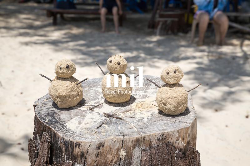 Three sand men on a beach in Kota Kinabalu
