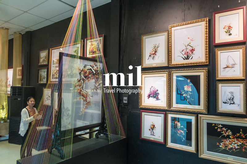 Traditional Vietnamese Silk Paintings being prepared and displayed.