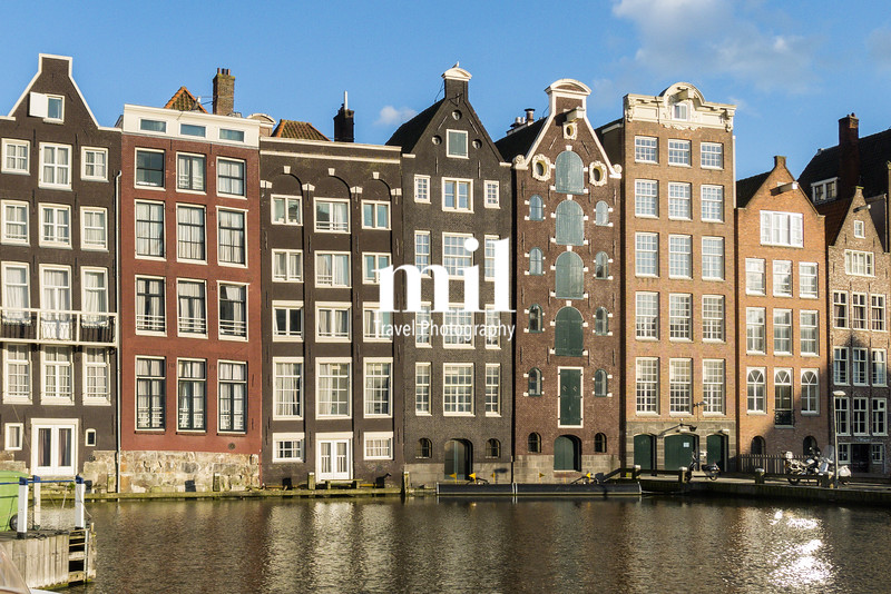 Houses in in a street by a canal in Amsterdam