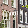 House in in a street by a canal in Amsterdam