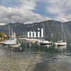 Boats in Bellagio on Lake Como with an alpine view