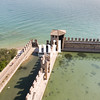 The fortress walls of Castello Scaligero in Sirmione on Lake Garda