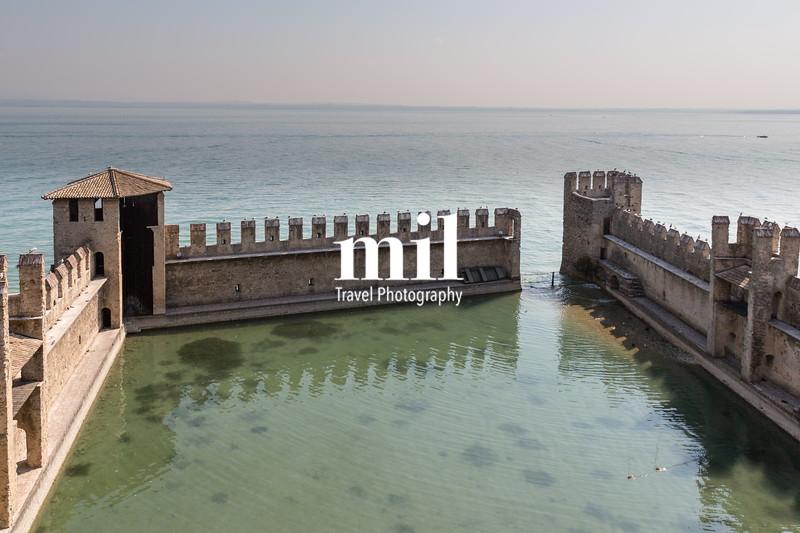 The fortress walls of Castello Scaligero in Sirmione on Lake Garda