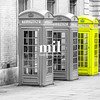 Five London Telephone boxes all in a row in black and white - one Yellow