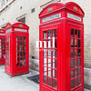 Three Red London Telephone boxes all in a row