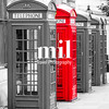 Five London Telephone boxes all in a row in black and white - one Red