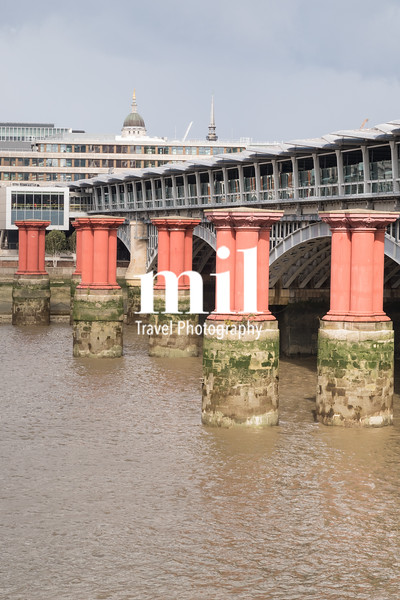 Red pillars in the River Thames between Blackfriars road bridge and Blackfriars railway bridge