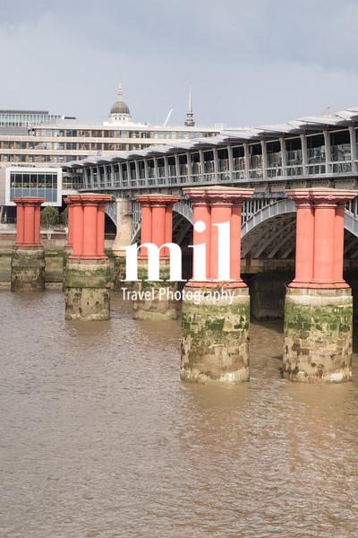 Red pillars in the River Thames between Blackfriars road bridge and Blackfriars railway bridge