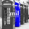 Five London Telephone boxes all in a row in black and white - one Blue