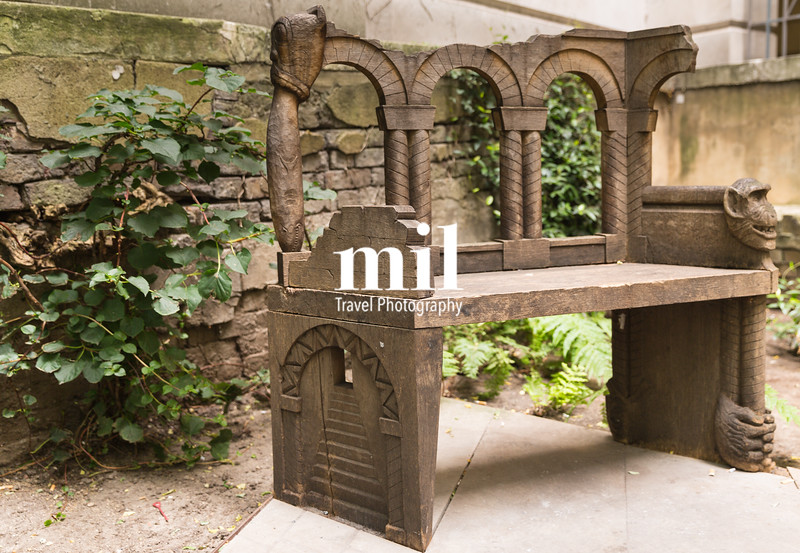 Old carved bench in the heart of the city of London