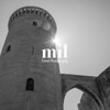 Old fortified castle high above Palma in Majorca in black and white with a natural sun starburst