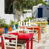 Coloured Tables in an outdoor Greek restaurant