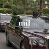 The Royal drivers parade their own puppets en route to Royal Ascot