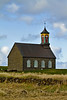 The church at Hvalsnes, Hvalsneskirkja, is an old stone built church from 1887.  Located not far from the fishing village Sandgerdi on Reykjanes Peninsula, Iceland. May 2012