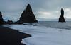 Basalt stacks and roaring Atlantic waves, Reynisfjara black sand beach, south Iceland.  October 2015