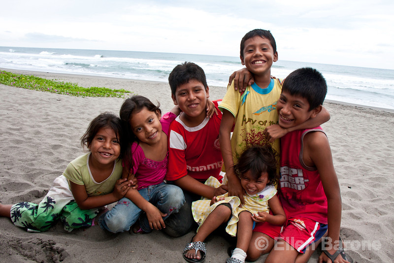 Local kids ham it up for the camera at Madresal eco beach camp and reserve, Pacific Coast, Chiapas, Mexico.
