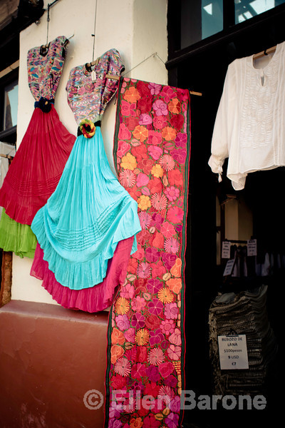 Colorful tapestries and clothing for sale in San Cristobal de las Casas, Chiapas, Mexico.