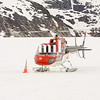 Helicopter landing on Glacier for dog sledges