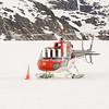 Helicopter landing on Glacier for dog sledges