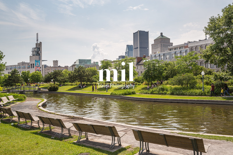 A quiet park in Montreal with the skyline