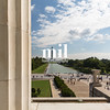 The view through the columns of the Lincoln Memorial to the Monument and the Capitol Building