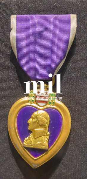 Purple Heart medal on a dark background