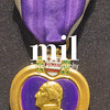 Purple Heart medal on a dark background