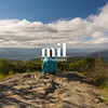 woman over looking the Blue Ridge Mountains after reaching the peak - inspirational view