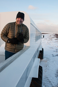 Inside the tundra buggy = warm with hot chocolate; outside on the observation deck = freezing with better views of bears