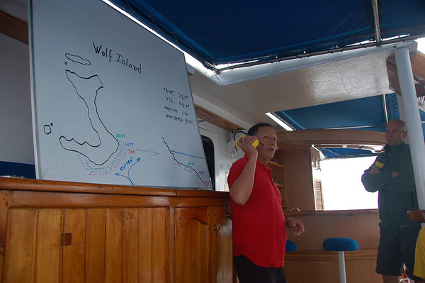 Jaime gives us a dive briefing and hands out our personal locator beacons, so the ship can find us if the current sweeps us out to sea