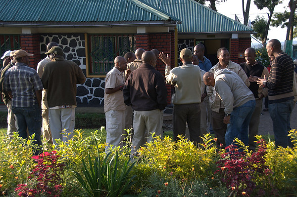 Guides and drivers exchange stories while we get our early-morning briefing at the Volcanoes National Park office