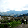 A small street in the village with a commanding view of the Cayambe volcano shown here hidden in clouds.