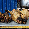 Otavalo Market<br /> <br /> Cow's heads and legs cooked over charcoal. Head innards are intact with brain and tongue.