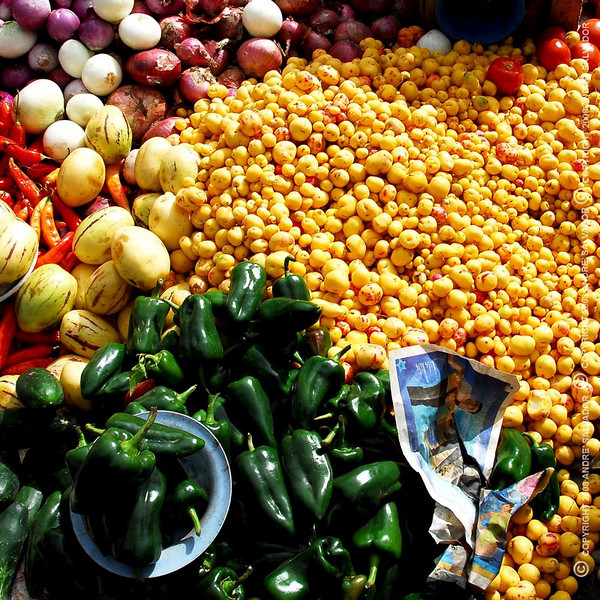 Otavalo Market<br /> <br /> Melons, red chilis, onions, tons of yellow potatoes, green chilis