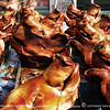 Otavalo Market<br /> <br /> Lechon or suckling pigs roasted over charcoal. A people's favorite in Ecuador.