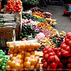 Otavalo Market<br /> <br /> Oranges, limes, tomatoes, yams, different types of potatoes, green chilis, green bell peppers, green onions, carrots, yellow and red bell peppers and yams.