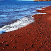 The beach is very inviting but hard to walk on if you are walking barefoot because of the gravel sized red lava rocks.