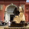 The sphinx further out in front of the main entrance of the Egyptian Musem. It is right after the gate. This museum was founded in 1858 by French archaeologist Auguste Mariette (whose tomb is in the museum's garden), the giant salmon-colored building was built in 1902