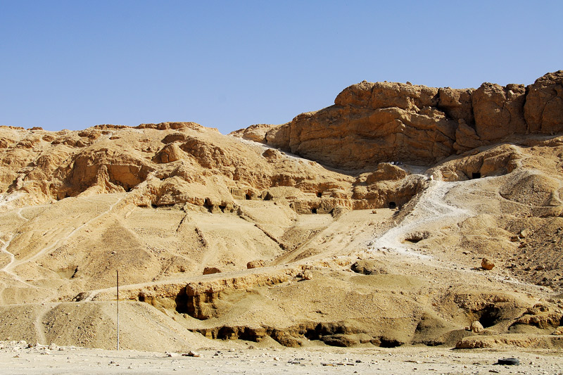 This is a view of the mountains sorrounding the Deir El-Bahri still with openings for underground tombs of unknown people.