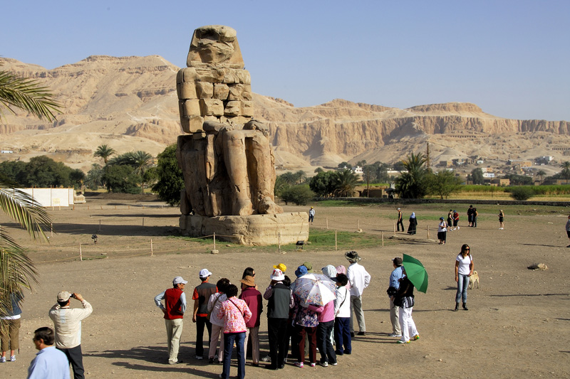 The massive stone statues of Pharaoh Amenhotep III, have for the past 3400 years stood in the Theban necropolis, across the River Nile from the modern city of Luxor.
