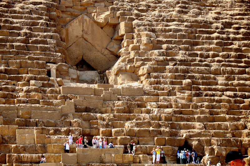 This is a closer view of the opening at the north side. You will observe that after the massive, horizontally layed, blocks of stones at the exterior, behind it are equally big blocks of stones but layed diagonally following the pyramid slope.
