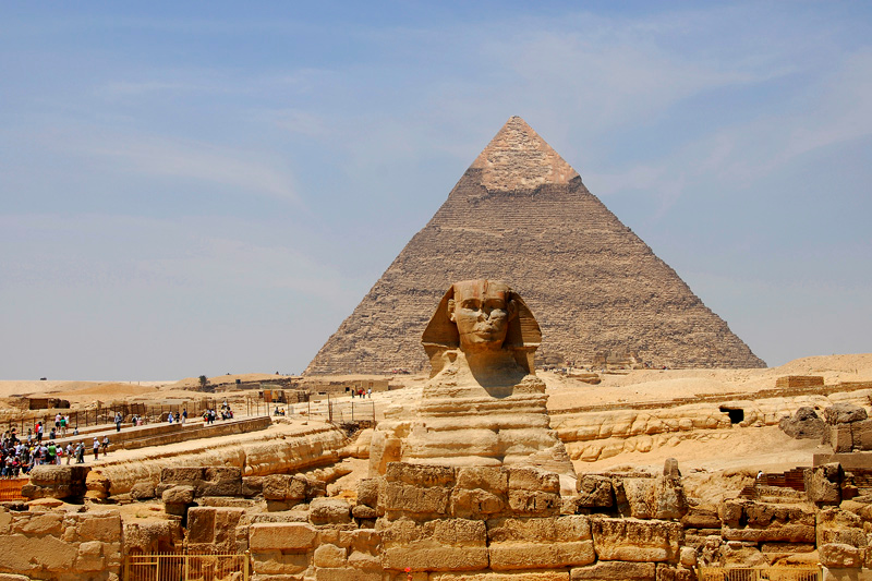 This is a view looking west towards the Great Sphinx and the Pyramid of Chepren (Khafre) behind.