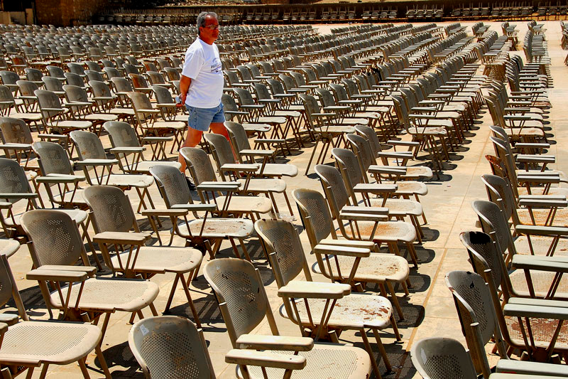 This fellow is looking at the sea of empty chairs at the east side of the Sphinx. The chairs are for the night's light show with the pyramids as backgound.