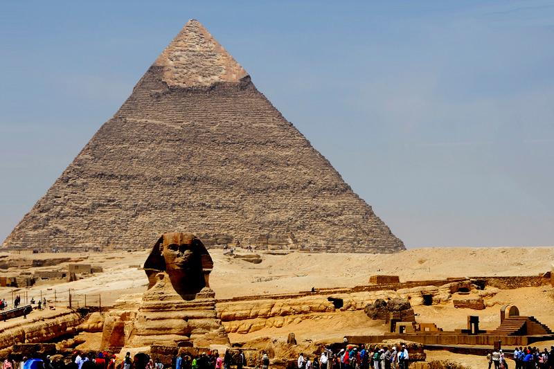 The great sphinx and the Chepren Pyramid. Notice the different slopes and elevations of land.