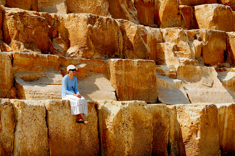 This is a good comparison of the size of the stone blocks against a full grown woman. This is at the north face of the Khufu Pyramid.
