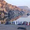 Pilegrims, preparing for a ritual morning bath. River Thungabadra. Hampi, India.