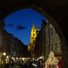 View of St. Michaels through arch at end of Charles bridge