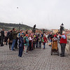 Charles bridge filled with hundreds of tourists and all kinds of vendors and musicians